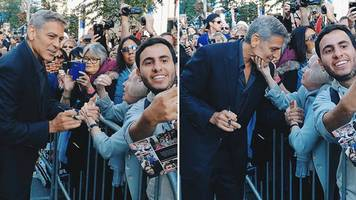 canada granny squeezes george clooney's face on red carpet