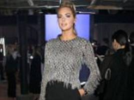 kate upton showcases slender frame in slinky silver top