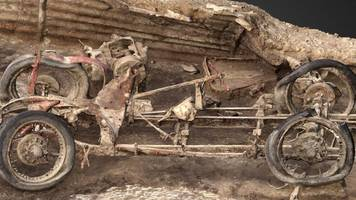 vintage car unearthed by archaeologists on salisbury plain