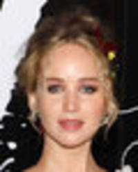 jennifer lawrence takes the plunge in boob-spilling dress