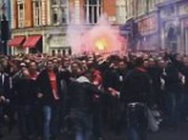 cologne fans march through london before arsenal game