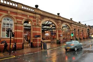 police hunt two football fans who sang racist songs at train passenger