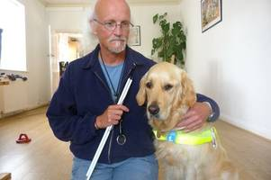 police investigating hate crime after blind man and guide dog allegedly barred from shop
