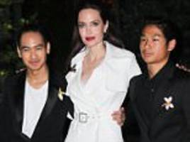 angelina jolie is sophisticated chic in trench coat dress