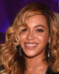 beyonce is 90% cleavage as boobs burst out of plunging dress
