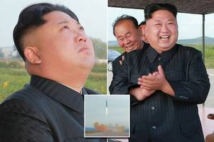 kim jong-un laughs as north korea launches missile and vows to be 'equilibrium of real force with us'