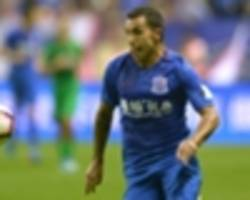 rare tevez goal is scant consolation for shenhua in humiliating defeat