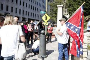not another charlottesville: richmond police enforce weapons ban ahead of confederate rally