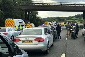 Two children and woman in 'life-threatening' condition after fatal M5 crash