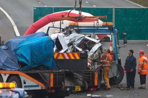 Woman and children remain in critical condition as police speak with lorry driver after M5 crash kills four