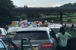 Woman and two children in critical condition after horror M5 lorry crash kills four