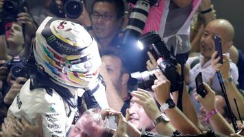Lewis Hamilton wins in Singapore after Ferrari crash