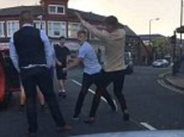Doncaster racegoers fight driver after spitting on car