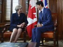 theresa may and justin trudeau agree new post brexit deal