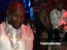 floyd mayweather flaunts mound of cash in vegas strip club
