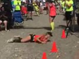 woman rolls across finish line of a washington marathon