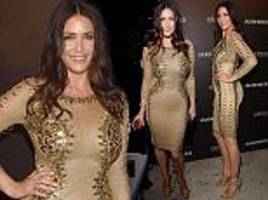 Lisa Snowdon flaunts hourglass curves in bodycon dress