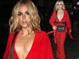 Tallia Storm sizzles in scarlet blouse at LFW show