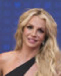 britney spears strips to teeny shorts and crop top for 'fashion week'