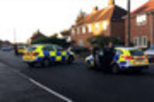 more photos from the scene of armed police raid in a street in...