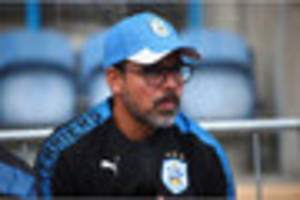 huddersfield town boss vows to field strong side against crystal...