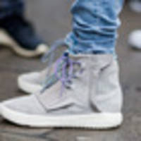 Knife pulled over pair of Kanye West Adidas Yeezy sneakers