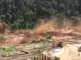 Construction workers flee after dam burst in Laos