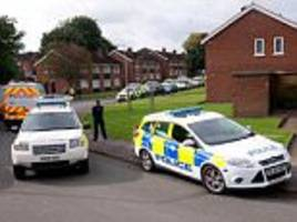 police at house where 'man and woman being held hostage'