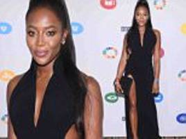 naomi campbell shows off model figure in low-cut dress