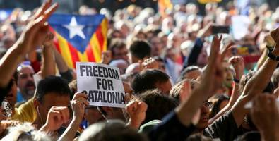 we are in a state of siege: spanish police arrest top catalan officials in referendum raids