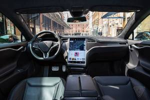 tesla is reportedly developing its own chip with amd for self-driving cars
