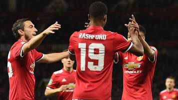 Rashford double for holders United