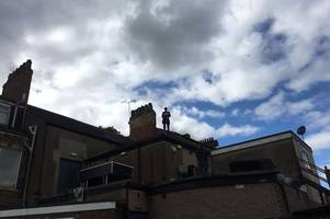 man arrested after spring bank rooftop stand-off