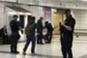 first video emerges after armed police and sniffer dogs close...