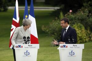 macron and may to warn facebook, google and twitter over radicalisation