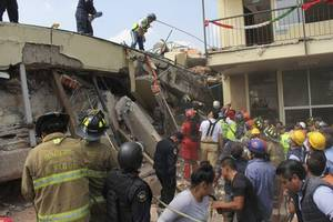 Rescuers wriggle into collapsed school after Mexico quake