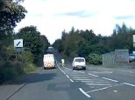 Scotland driver overtakes van and almost hits road worker