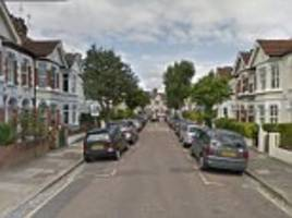 two arrested after body is found in west london garden