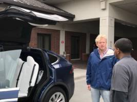 the tesla road trip — we show off the falcon wing doors on the model x and eat lunch at warren buffett's favorite steakhouse