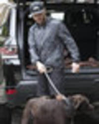 ant in the doghouse: troubled star spotted walking pet pooch without his wife