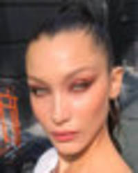 Bella Hadid provides braless peep show as model unleashes assets