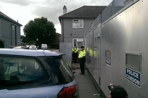 sunbury terror raid: steel fence erected at cavendish road home after parsons green attack taken down but officers remain at scene