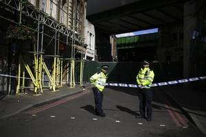 uk police arrest sixth man in investigation into bomb attack in london subway