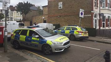 southfields burned garden body: two charged with murder
