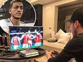 Mesut Ozil promises Arsenal return soon as he plays PES