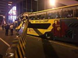 children hurt when roof of taiwanese coach is 'shorn' off