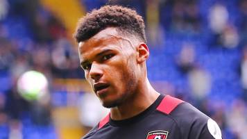 tyrone mings: bournemouth defender ruled out for a month with back injury