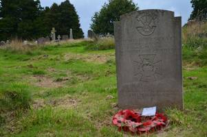 apology to families after complaints that knee high grass covered headstones of tiverton's war heroes