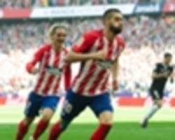 atletico madrid 2 sevilla 0: carrasco, griezmann send simeone's side second