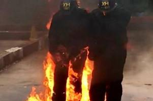 Watch petrol bomb being thrown at police officers as they learn what to do in a riot